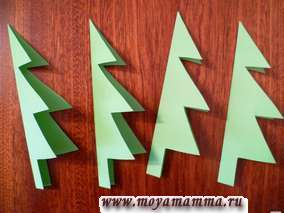 Новогодняя елка из бумаги своими руками. Раскладываем получившиеся четыре елки.