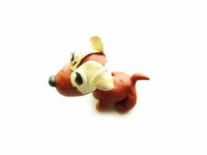 щенок из пластилина разноцветного окраса шерсти