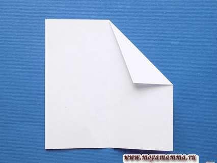 Сгибание правого угла по диагонали верхнего правого квадрата