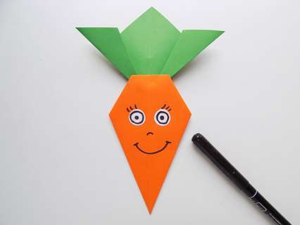 Аппликация морковки. Рисуем глазки, носик и ротик.
