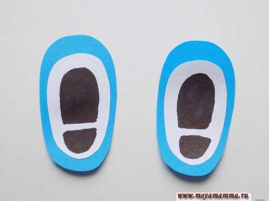 Овальные заготовки из белой и голубой бумаги