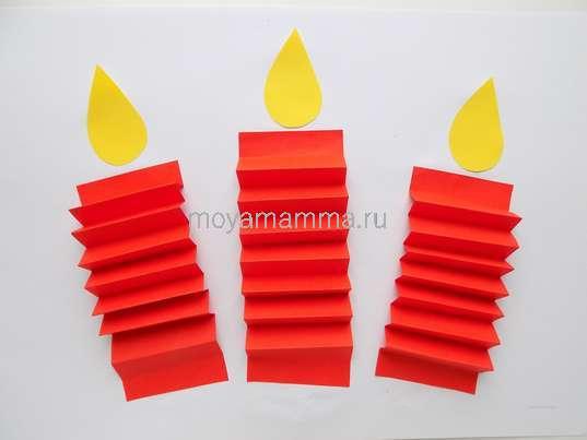 Аппликация свечи. Приклеивание язычков пламени